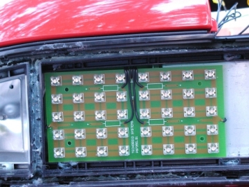STOP/TAIL PCB mounted in housing inside the car.